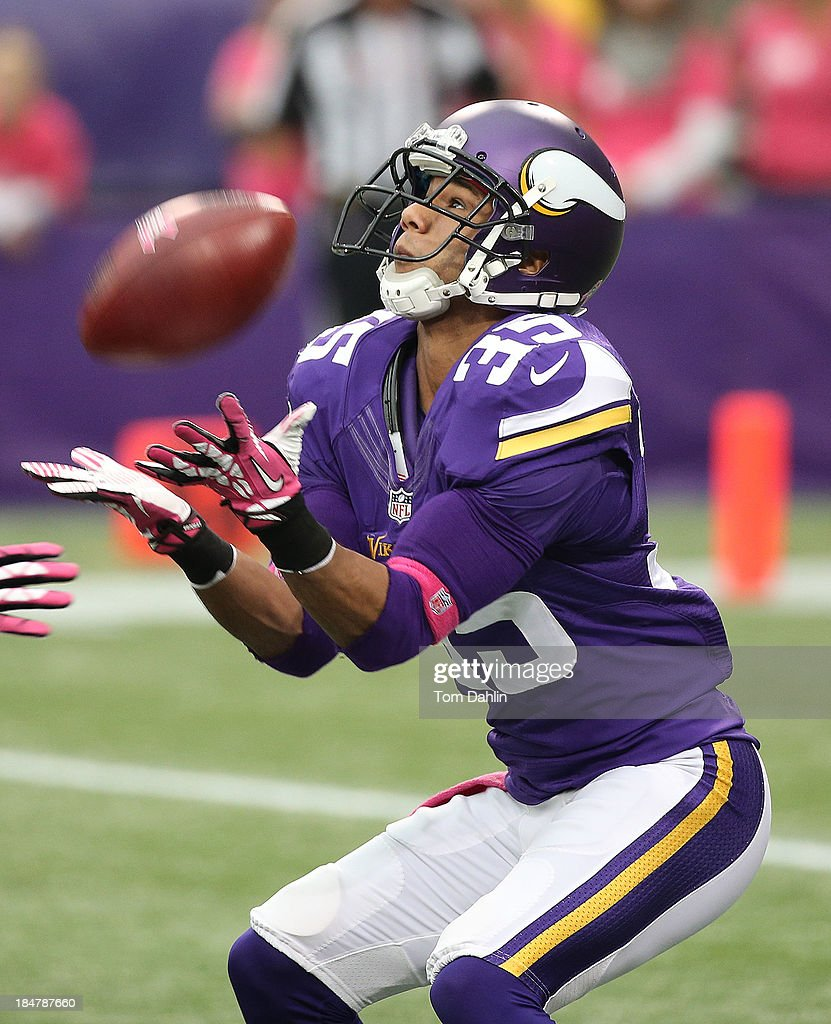 Marcus Sherels of the Minnesota Vikings receivers a punt during an NFL game against the Carolina Panthers at Mall of America Field on October 13 2013...