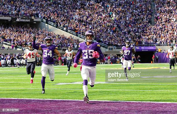 Marcus Sherels of the Minnesota Vikings returns a punt 79 yards for a touchdown in the second quarter of the game against the Houston Texans on...