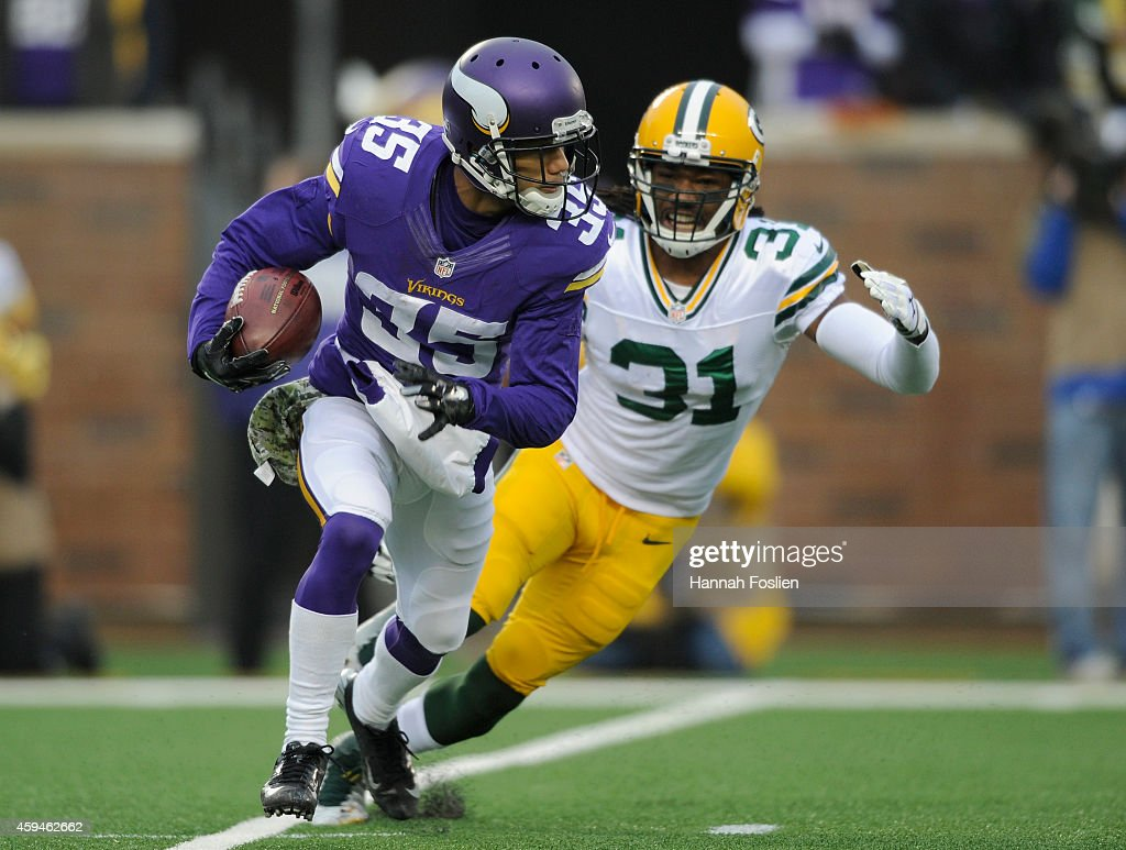 Marcus Sherels of the Minnesota Vikings returns a punt against Davon House of the Green Bay Packers during the first quarter of the game on November...