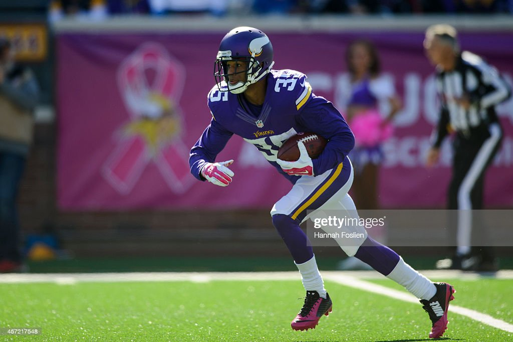 Marcus Sherels of the Minnesota Vikings returns a punt during the game against the Detroit Lions on October 12 2014 at TCF Bank Stadium in...
