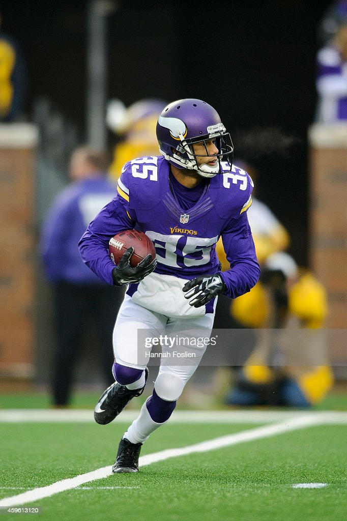 Marcus Sherels of the Minnesota Vikings returns a punt during the game against the Green Bay Packers on November 23 2014 at TCF Bank Stadium in...