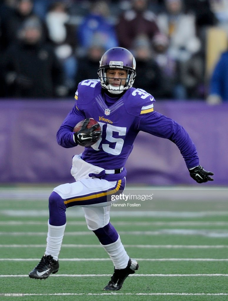 Marcus Sherels of the Minnesota Vikings returns a punt during the fourth quarter of the game against the Carolina Panthers on November 30 2014 at TCF...