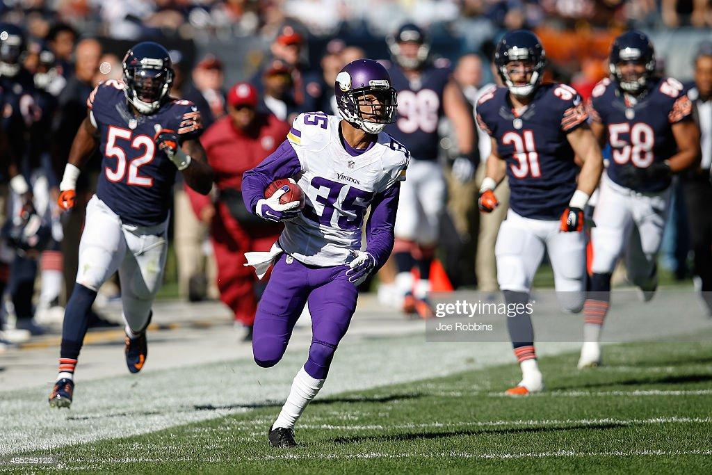 Marcus Sherels of the Minnesota Vikings runs the football toward the endzone for a 65 yard punt return against the Chicago Bears in the first quarter...