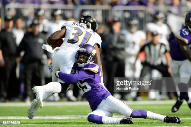 Marcus Sherels of the Minnesota Vikings tackles Bobby Rainey of the Baltimore Ravens on a kick return during the game on October 22 2017 at US Bank...