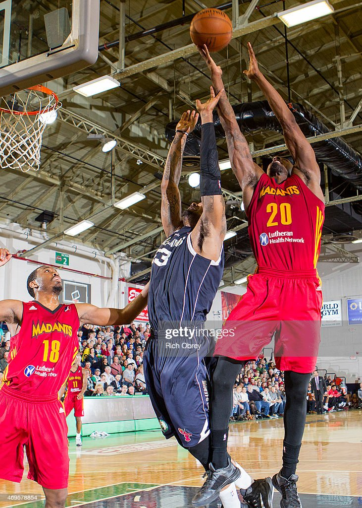 Marcus Simmons #20 of the Fort Wayne Mad Ants pulls in a defensive rebound over <a gi-track='captionPersonalityLinkClicked' href=/galleries/search?phrase=Romero+Osby&family=editorial&specificpeople=5757556 ng-click='$event.stopPropagation()'>Romero Osby</a> #23 of the Maine Red Claws during Playoff Game #2 on April 11, 2015 at the Portland Expo.