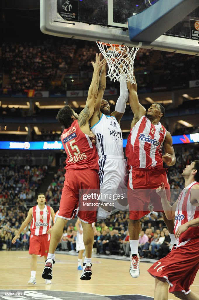 Marcus Slaughter, #44 of Real Madrid competes with Kyle Hines,#4 and Georgios Printezis, #15 of Olympiacos Piraeus during the Turkish Airlines EuroLeague Final game between Olympiacos Piraeus v Real Madrid at O2 Arena on May 12, 2013 in London, United Kingdom.