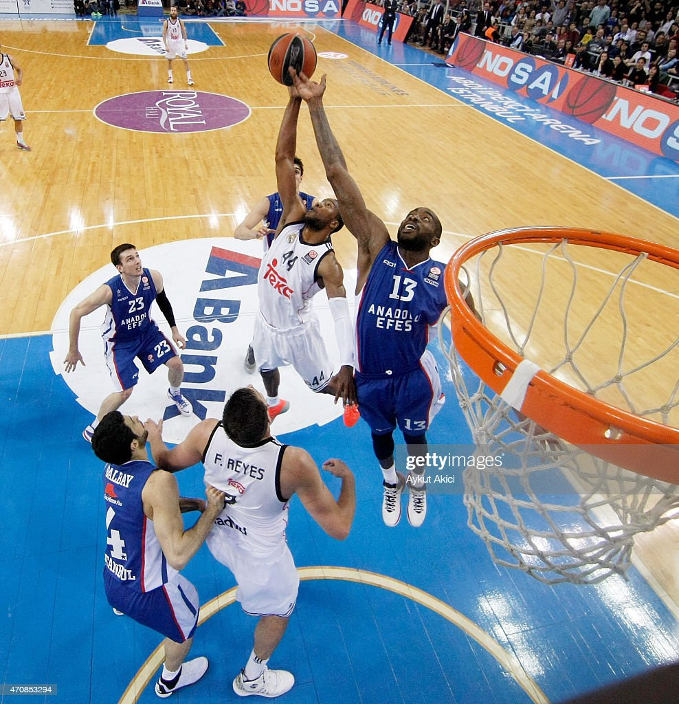 Marcus Slaughter, #44 of Real Madrid competes with <a gi-track='captionPersonalityLinkClicked' href=/galleries/search?phrase=Stephane+Lasme&family=editorial&specificpeople=814288 ng-click='$event.stopPropagation()'>Stephane Lasme</a>, #13 of Anadolu Efes Istanbul during the 2014-2015 Turkish Airlines Euroleague Basketball Play Off Game 4 between Anadolu Efes Istanbul v Real Madrid at Abdi Ipekci Arena on April 23, 2015 in Istanbul, Turkey.