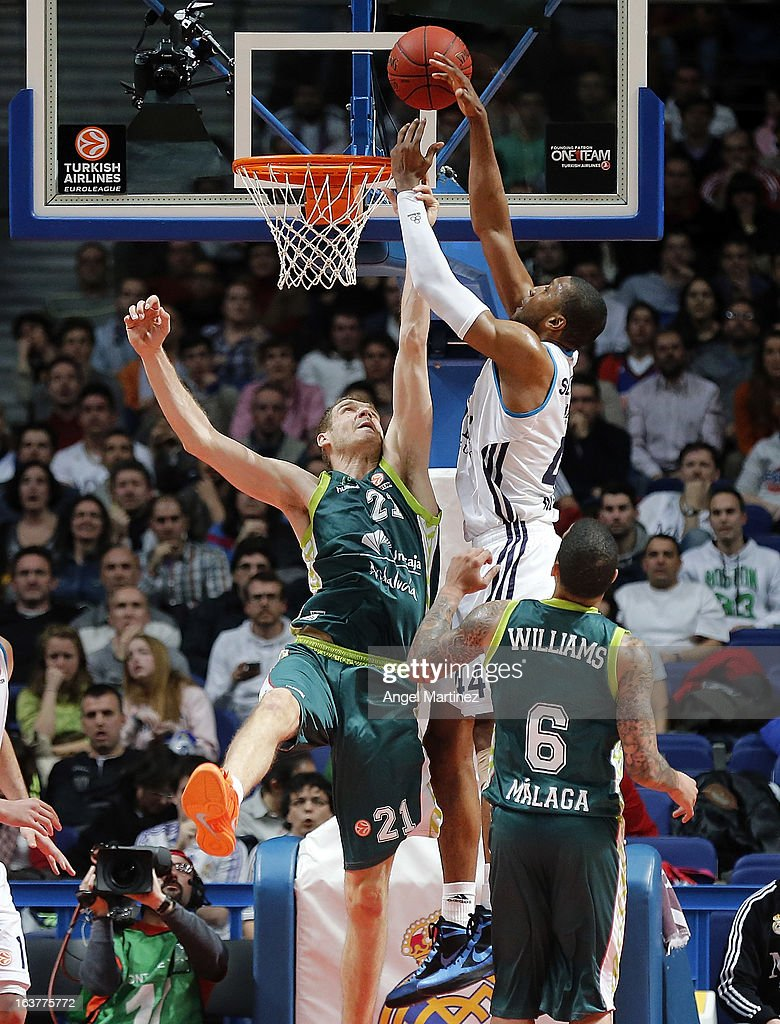 Marcus Slaughter #44 of Real Madrid aims to shoot over Luka Zoric #21 of Unicaja Malaga during the Turkish Airlines Euroleague Top 16 game at Palacio de los Deportes on March 15, 2013 in Madrid, Spain.