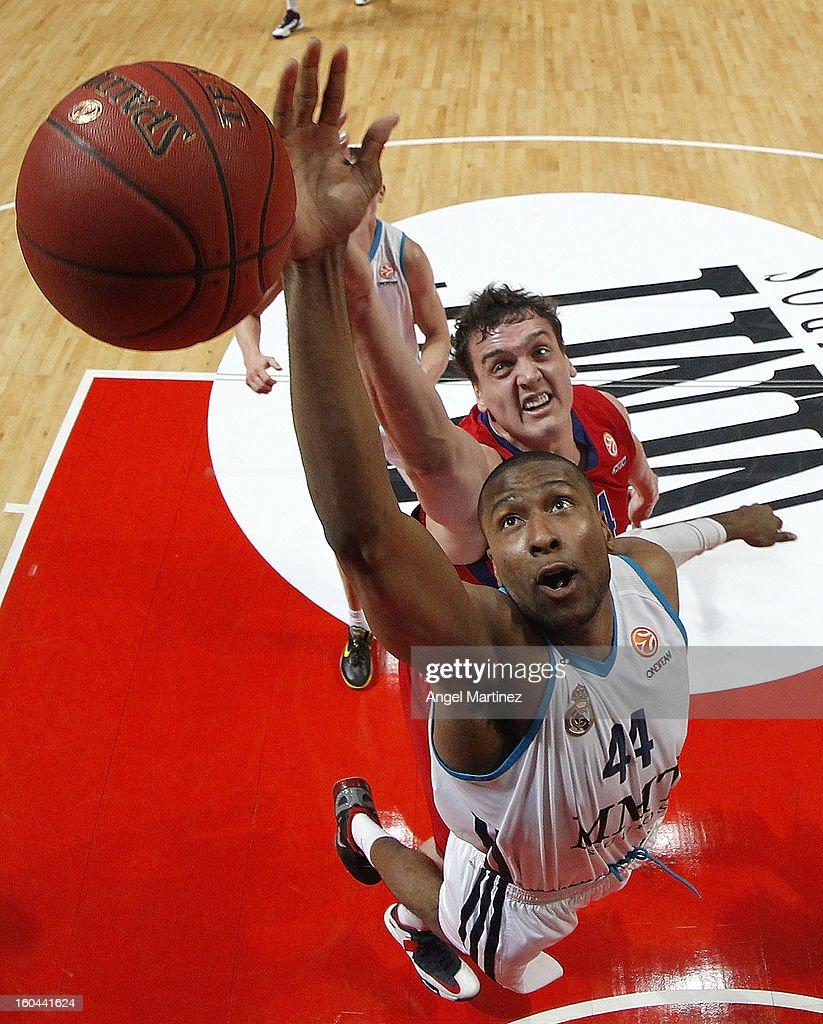 Marcus Slaughter #44 of Real Madrid grabs a rebound aginst <a gi-track='captionPersonalityLinkClicked' href=/galleries/search?phrase=Sasha+Kaun&family=editorial&specificpeople=802084 ng-click='$event.stopPropagation()'>Sasha Kaun</a> #24 of CSKA Moscow during the Turkish Airlines Euroleague Top 16 game at Palacio de los Deportes on January 31, 2013 in Madrid, Spain.