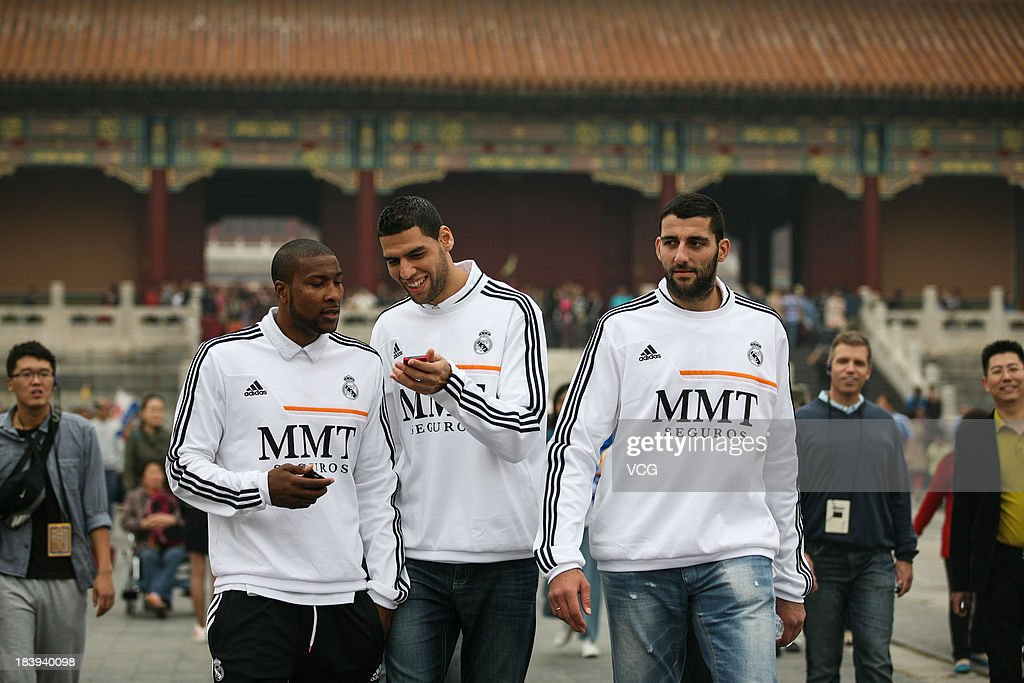 Marcus Slaughter Salah Mejri and Ioannis Bourousis of Real Madrid basketball team visit the Forbidden City on October 9 2013 in Beijing China