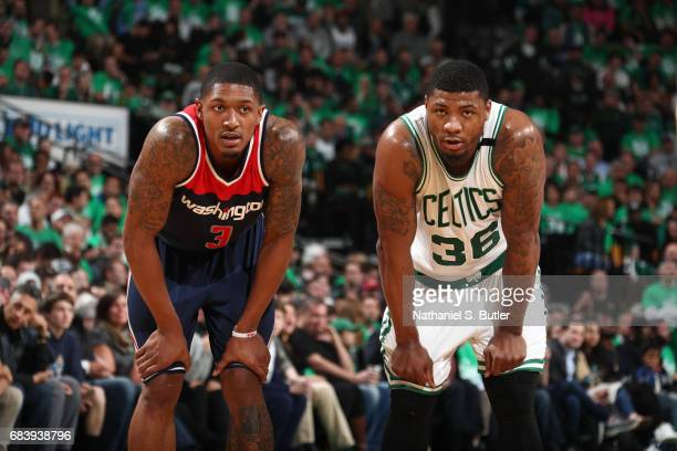 Marcus Smart and Bradley Beal of the Washington Wizards look on during Game Seven of the Eastern Conference Semifinals of the 2017 NBA Playoffs on...