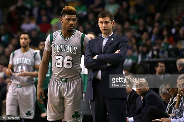 Marcus Smart and head coach Brad Stevens of the Boston Celtics look on in the second quarter against the Miami Heat at TD Garden on April 13 2016 in...