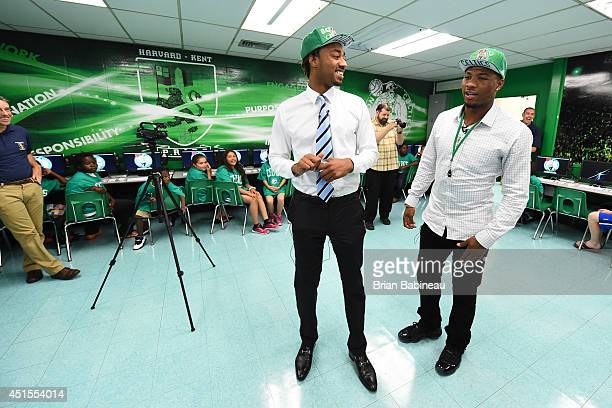 Marcus Smart and James Young of the Boston Celtics help unveil a renovated technology lab on June 30 2014 at Harvard Kent Elementary School in...