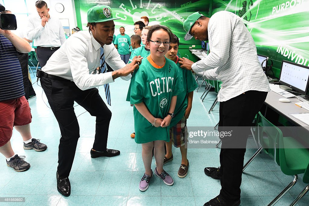 Marcus Smart and James Young of the Boston Celtics sign autographs and help unveil a renovated technology lab on June 30, 2014 at Harvard Kent Elementary School in Charlestown, Massachusetts .