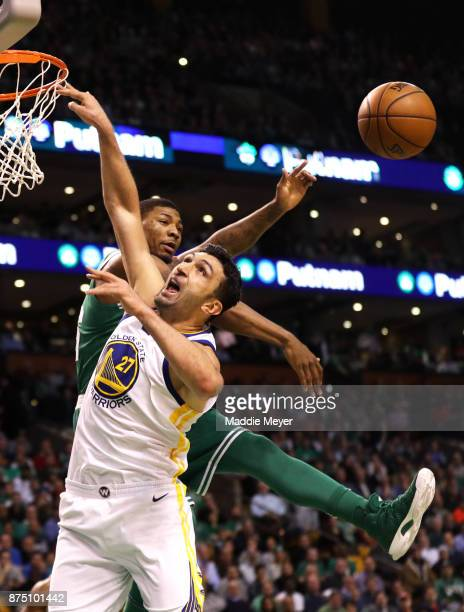 Marcus Smart of the Boston Celtics blocks a shot from Zaza Pachulia of the Golden State Warriors during the first quarter at TD Garden on November 16...
