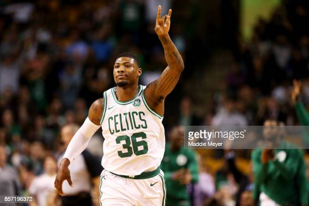 Marcus Smart of the Boston Celtics celebrates after hitting a three point shot against the Charlotte Hornets during the first half at TD Garden on...