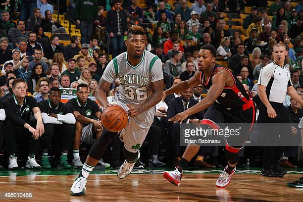Marcus Smart of the Boston Celtics drives to the basket against the Toronto Raptors during the game on October 30 2015 at TD Garden in Boston...
