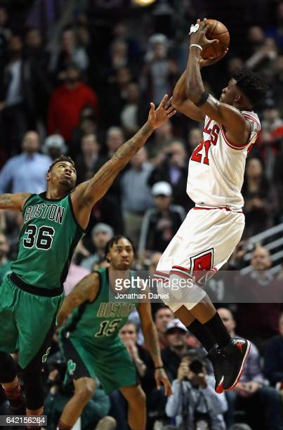 Marcus Smart of the Boston Celtics fouls Jimmy Butler of the Chicago Bulls in the closing second at the United Center on February 16 2017 in Chicago...
