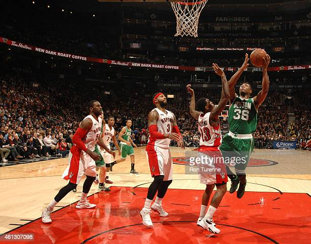 Marcus Smart of the Boston Celtics goes to the basket against the Toronto Raptors on January 10 2015 at the Air Canada Centre in Toronto Ontario...