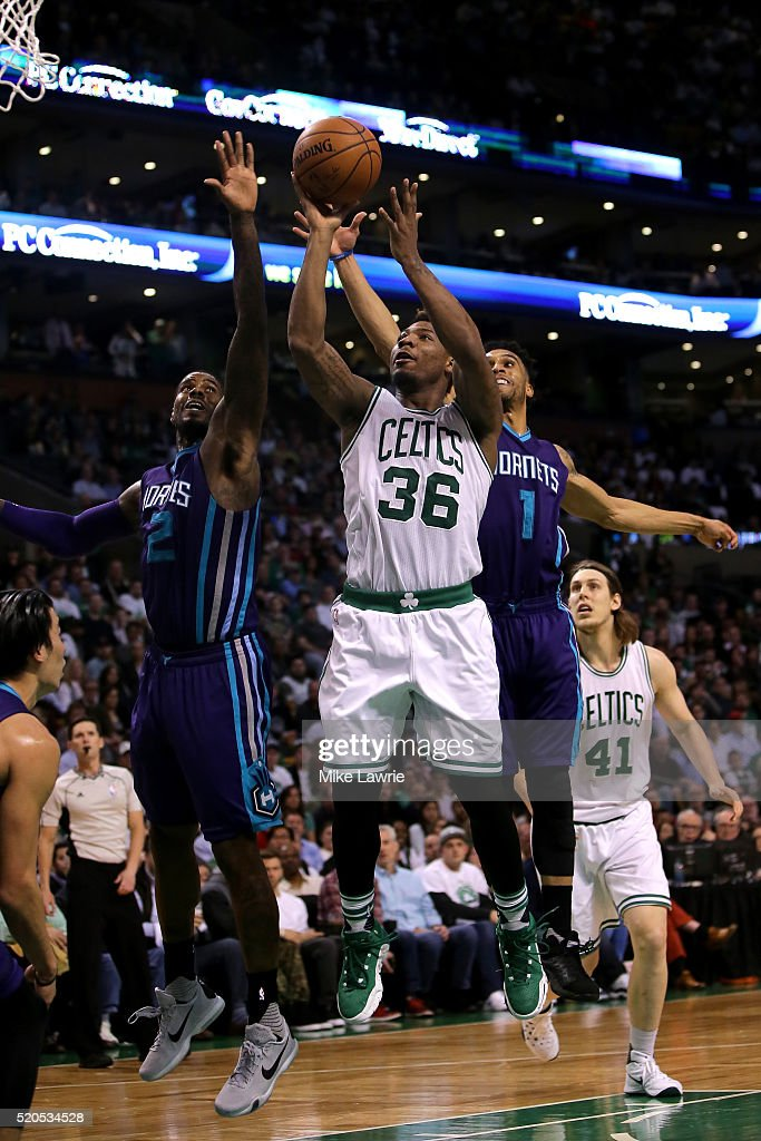 Marcus Smart #36 of the Boston Celtics goes up with the ball against Marvin Williams #2 and Courtney Lee #1 of the Charlotte Hornets in the third quarter at TD Garden on April 11, 2016 in Boston, Massachusetts.