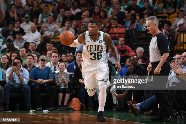 Marcus Smart of the Boston Celtics handles the ball against the Charlotte Hornetsduring a preseason game on October 2 2017 at the TD Garden in Boston...