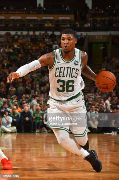 Marcus Smart of the Boston Celtics handles the ball against the Philadelphia 76ers during a preseason game on October 9 2017 at TD Garden in Boston...