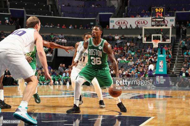 Marcus Smart of the Boston Celtics handles the ball against the Charlotte Hornets on October 11 2017 at Spectrum Center in Charlotte North Carolina...