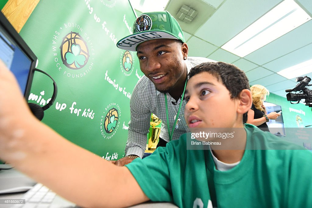 Marcus Smart of the Boston Celtics helps unveil a renovated technology lab on June 30, 2014 at Harvard Kent Elementary School in Charlestown, Massachusetts .