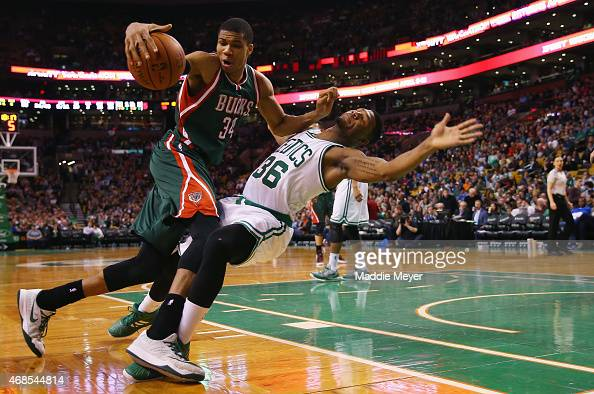 Marcus Smart of the Boston Celtics is called for a charge against Giannis Antetokounmpo of the Milwaukee Bucks during the third quarter at TD Garden...