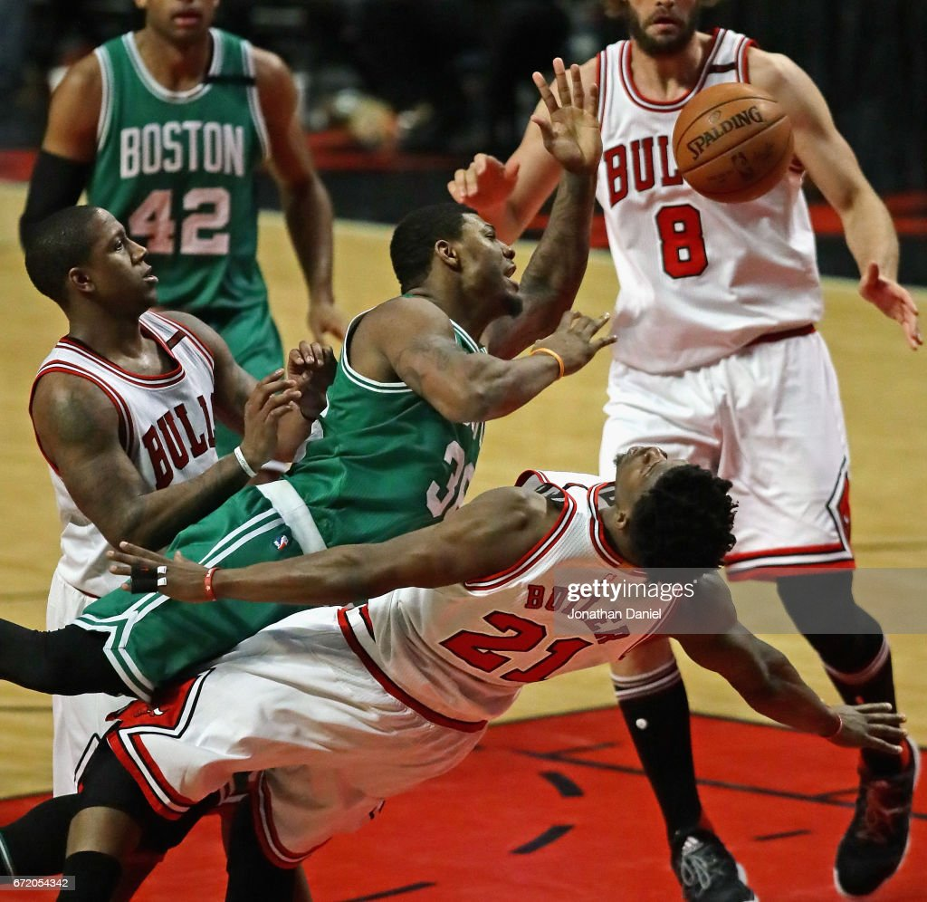 Marcus Smart #36 of the Boston Celtics is called for a charge against Jimmy Butler #21 of the Chicago Bulls as he tries to move between Butler and Isaiah Canaan #0 (L) during Game Four of the Eastern Conference Quarterfinals during the 2017 NBA Playoffs at the United Center on April 23, 2017 in Chicago, Illinois.