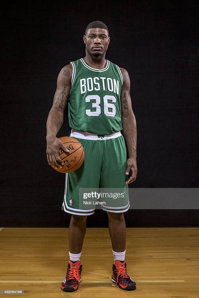 <a gi-track='captionPersonalityLinkClicked' href=/galleries/search?phrase=Marcus+Smart&family=editorial&specificpeople=7887125 ng-click='$event.stopPropagation()'>Marcus Smart</a> #36 of the Boston Celtics poses for a portrait during the 2014 NBA rookie photo shoot at MSG Training Center on August 3, 2014 in Tarrytown, New York.