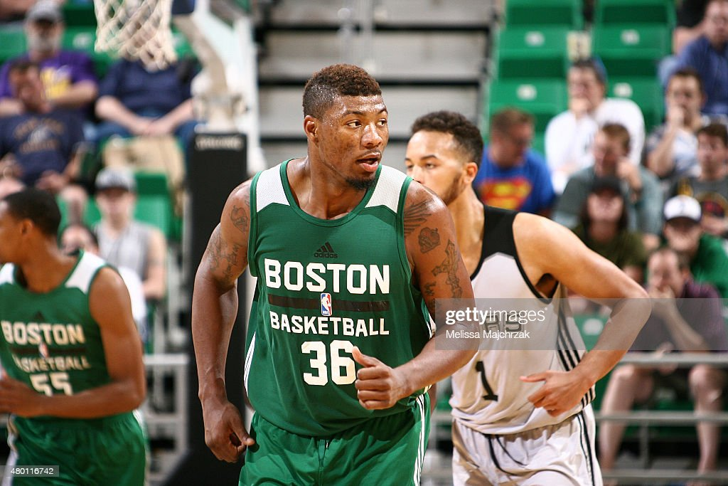 <a gi-track='captionPersonalityLinkClicked' href=/galleries/search?phrase=Marcus+Smart&family=editorial&specificpeople=7887125 ng-click='$event.stopPropagation()'>Marcus Smart</a> #36 of the Boston Celtics reacts to a play against the San Antonio Spurs during the Utah Jazz Summer League game on July 9, 2015 at EnergySolutions Arena in Salt Lake City, Utah.