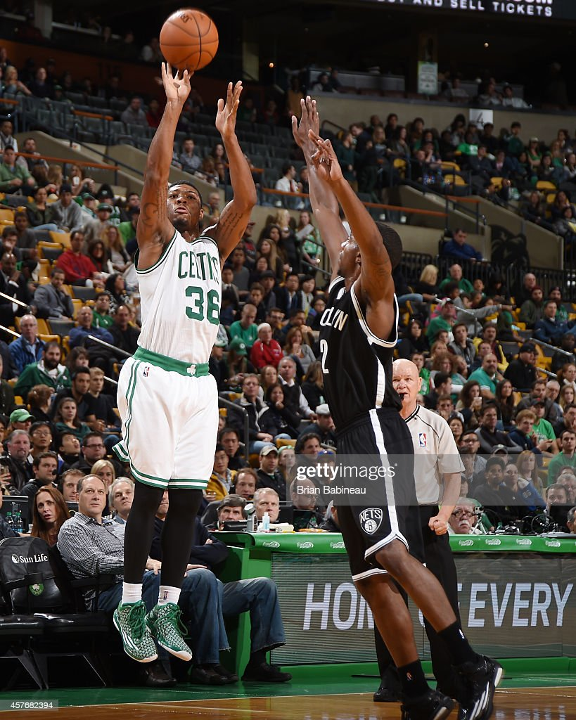 Marcus Smart #36 of the Boston Celtics shoots against Markel Brown #22 of the Brooklyn Nets during the game on October 22, 2014 at the TD Garden in Boston, Massachusetts.