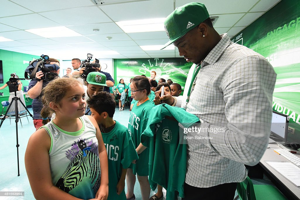 Marcus Smart of the Boston Celtics signs autographs and helps unveil a renovated technology lab on June 30, 2014 at Harvard Kent Elementary School in Charlestown, Massachusetts .