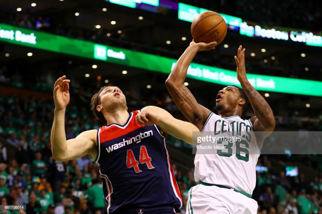 Marcus Smart #36 of the Boston Celtics takes a shot against Bojan Bogdanovic #44 of the Washington Wizards during the second half of Game Five of the Eastern Conference Semifinals at TD Garden on May 10, 2017 in Boston, Massachusetts. The Celtics defeat the Wizards 123-101.