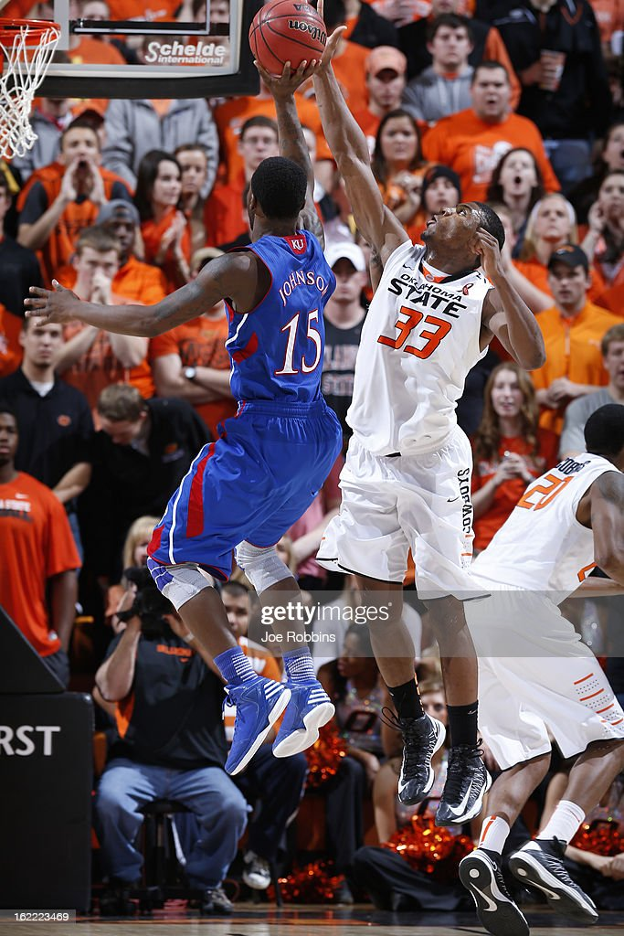 <a gi-track='captionPersonalityLinkClicked' href=/galleries/search?phrase=Marcus+Smart&family=editorial&specificpeople=7887125 ng-click='$event.stopPropagation()'>Marcus Smart</a> #33 of the Oklahoma State Cowboys blocks a shot against Elijah Johnson #10 of the Kansas Jayhawks during the game at Gallagher-Iba Arena on February 20, 2013 in Stillwater, Oklahoma. Kansas won 68-67 in two overtimes.
