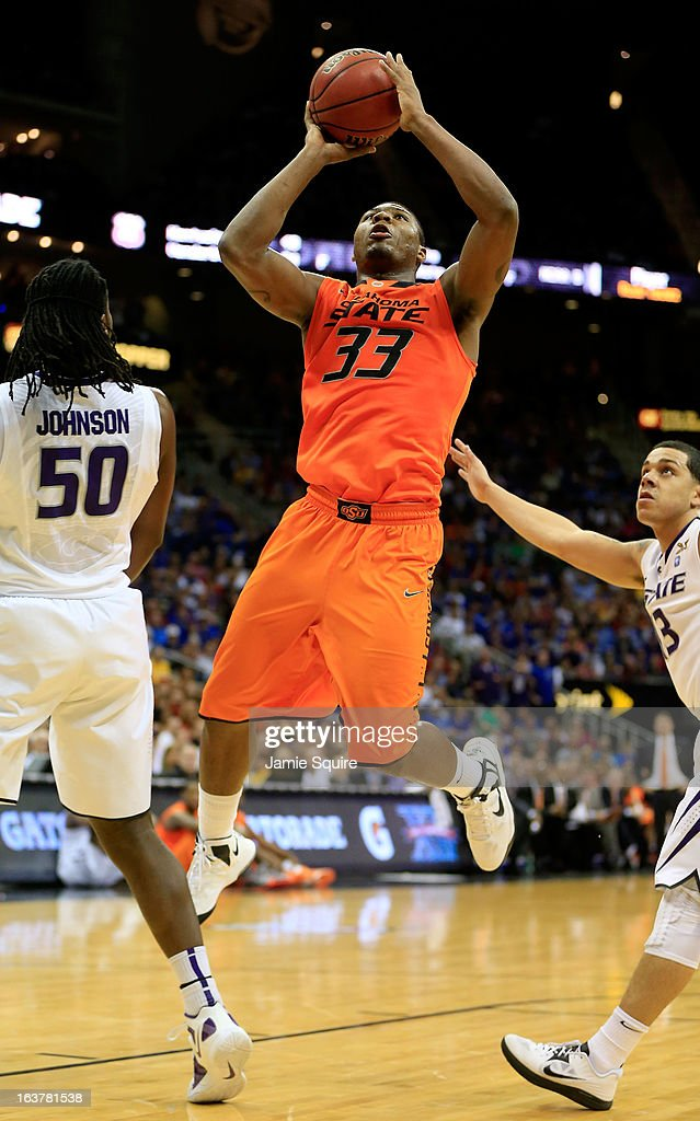 Marcus Smart #33 of the Oklahoma State Cowboys shoots against D.J. Johnson #50 and Angel Rodriguez #13 of the Kansas State Wildcats in the first half during the Semifinals of the Big 12 basketball tournament at the Sprint Center on March 15, 2013 in Kansas City, Missouri.