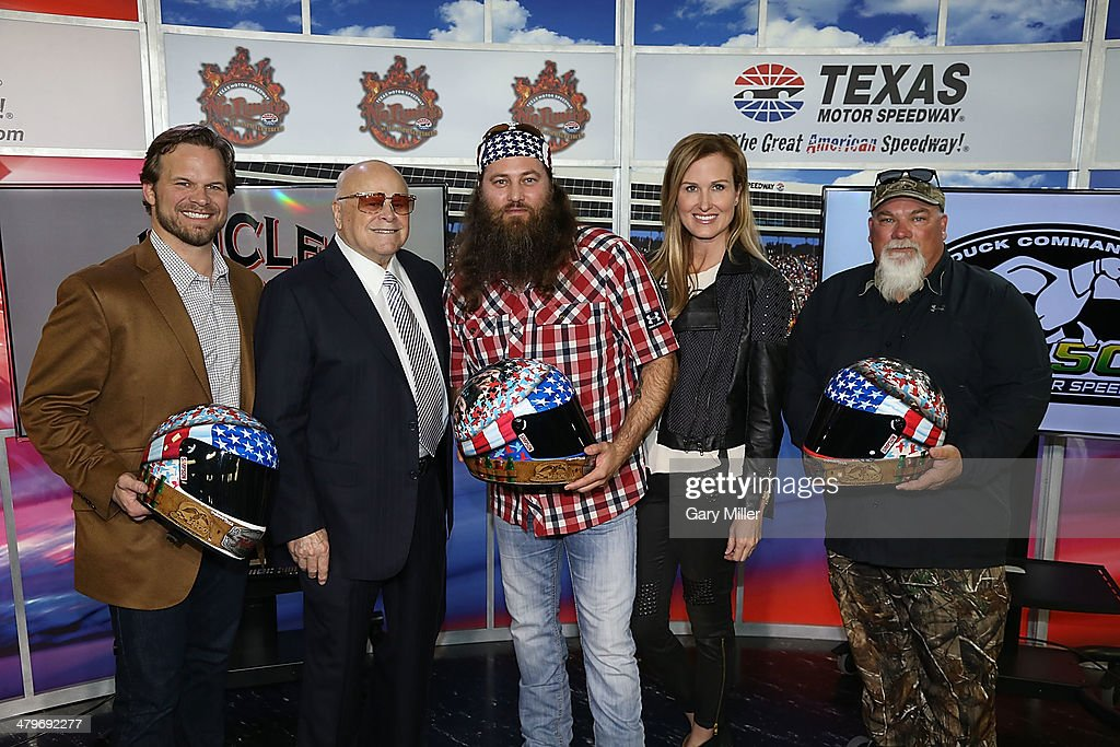 Marcus Smith, Bruton Smith, <a gi-track='captionPersonalityLinkClicked' href=/galleries/search?phrase=Willie+Robertson&family=editorial&specificpeople=2788954 ng-click='$event.stopPropagation()'>Willie Robertson</a>, <a gi-track='captionPersonalityLinkClicked' href=/galleries/search?phrase=Korie+Robertson&family=editorial&specificpeople=9195966 ng-click='$event.stopPropagation()'>Korie Robertson</a> and John Godwin pose during the press conference for the unveiling of 'Big Hoss' the largest HD video board in the world at Texas Motor Speedway on March 19, 2014 in Fort Worth, Texas.