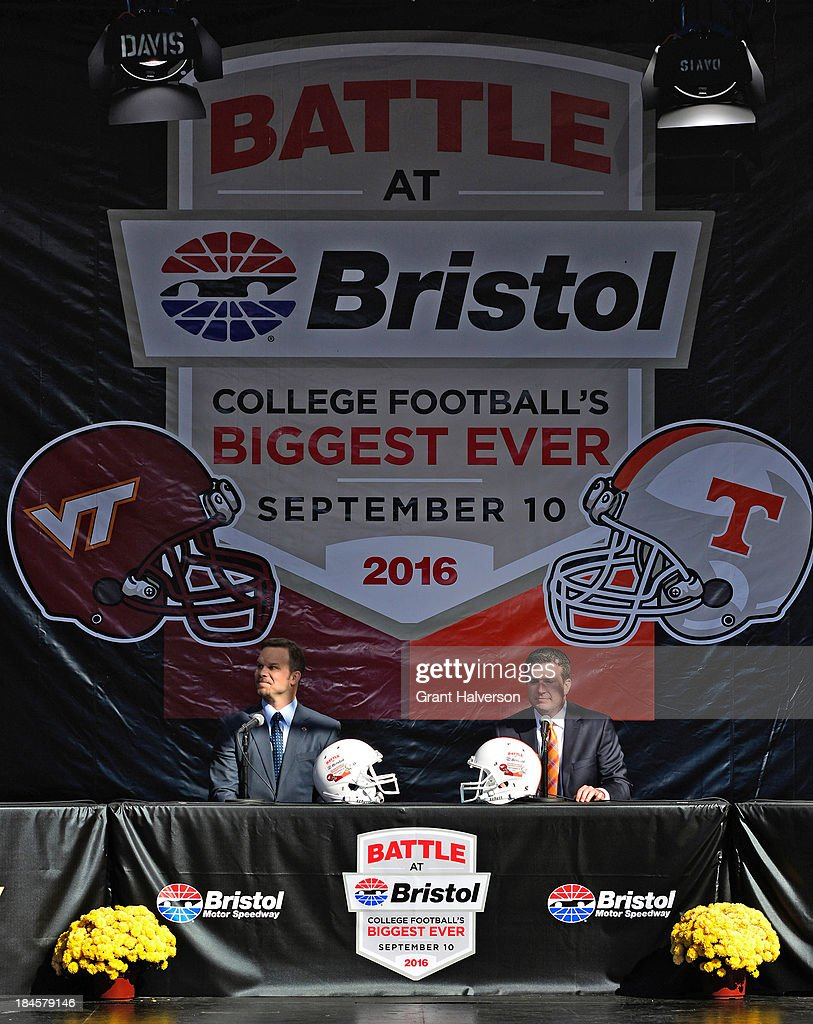 Marcus Smith, left, president and COO of Speedway Motorsports, and Jerry Caldwell, general manager of Bristol Motor Speedway, look out at the crowd during a press conference at Bristol Motor Speedway on October 14, 2013 in Bristol, Tennessee. Bristol Motor Speedway plans to transform the legendary Speedway into the world's largest football stadium for the inaugural Battle at Bristol, to be held on Saturday, September 10, 2016. The event will feature a game between the Virginia Tech Hokies and Tennessee Volunteers and is projected to set the NCAA record for highest single-game attendance.