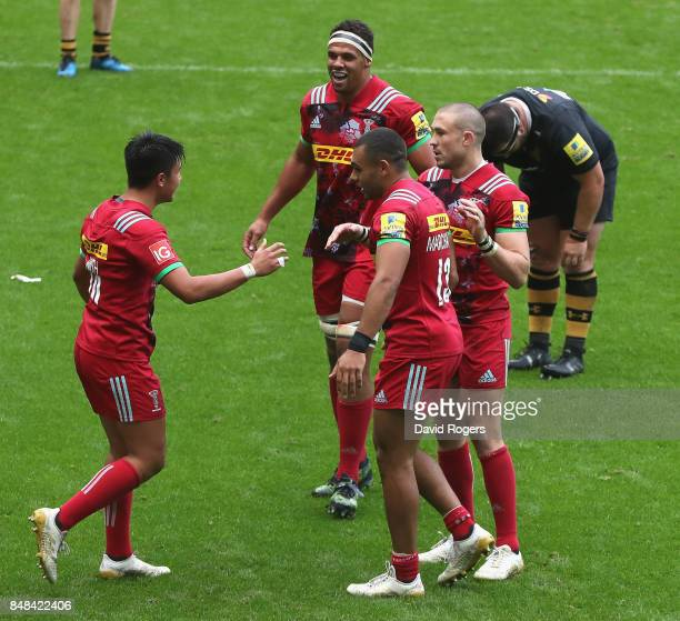 Marcus Smith of Harlequins is congratulated by team mates after their victory during the Aviva Premiership match between Wasps and Harlequins at The...