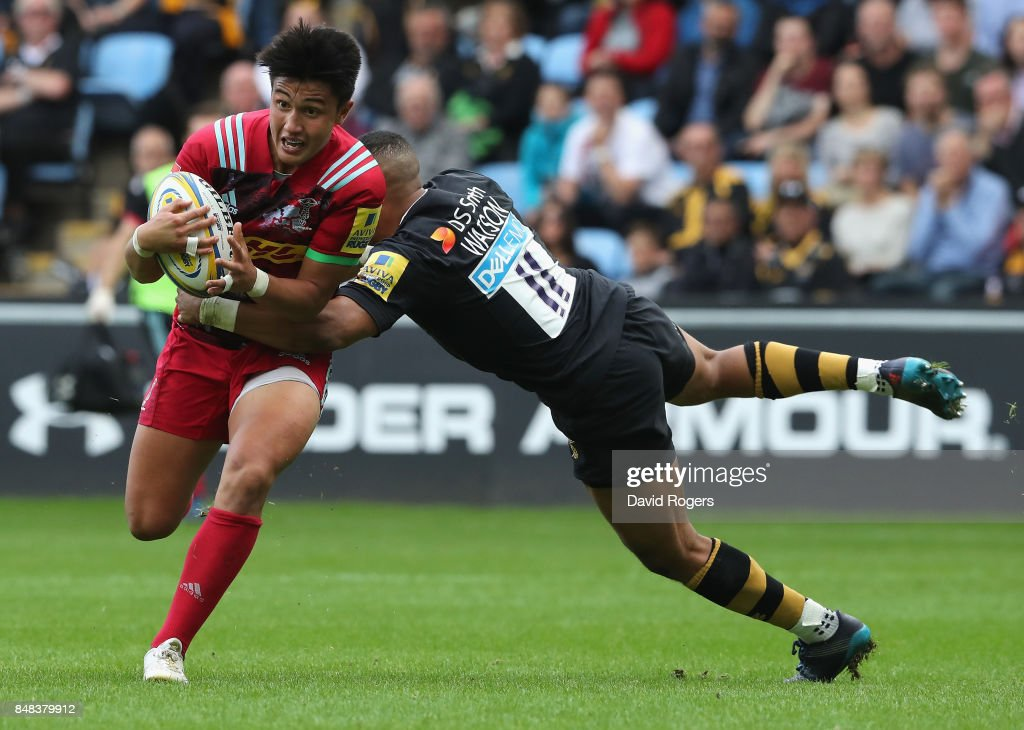 Marcus Smith of Harlequins is tackled by Marcus Waton during the Aviva Premiership match between Wasps and Harlequins at The Ricoh Arena on September 17, 2017 in Coventry, England.