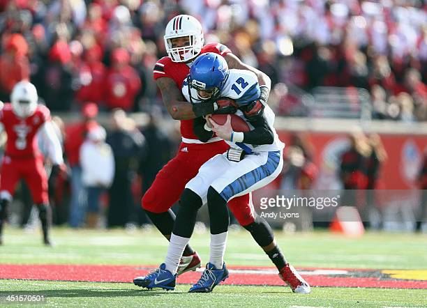 Marcus Smith of the Louisville Cardinals sacks Paxton Lynch of the Memphis Tigers during the game at Papa John's Cardinal Stadium on November 23 2013...
