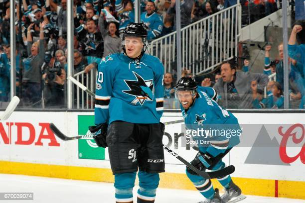 Marcus Sorensen and Brenden Dillon of the San Jose Sharks react to Sorensen's goal in the second period against the Edmonton Oilers in Game Four of...