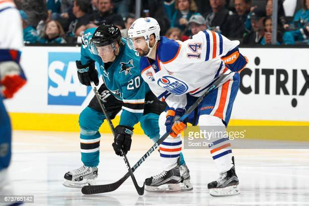 Marcus Sorensen of the San Jose Sharks and Jordan Eberle of the Edmonton Oilers get ready in Game Six of the Western Conference First Round during...