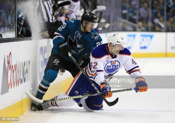 Marcus Sorensen of the San Jose Sharks checks Anton Slepyshev of the Edmonton Oilers during Game Six of the Western Conference First Round during the...