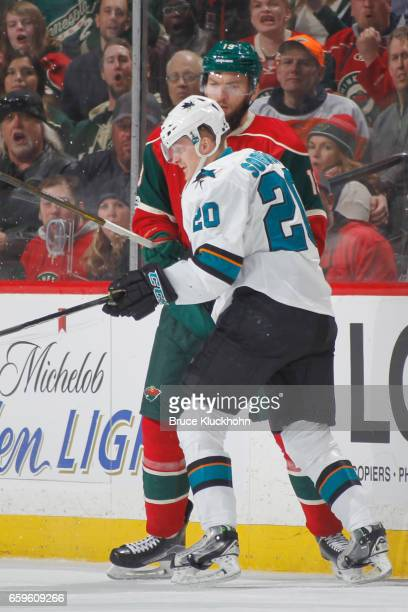 Marcus Sorensen of the San Jose Sharks defends Martin Hanzal of the Minnesota Wild during the game on March 21 2017 at the Xcel Energy Center in St...