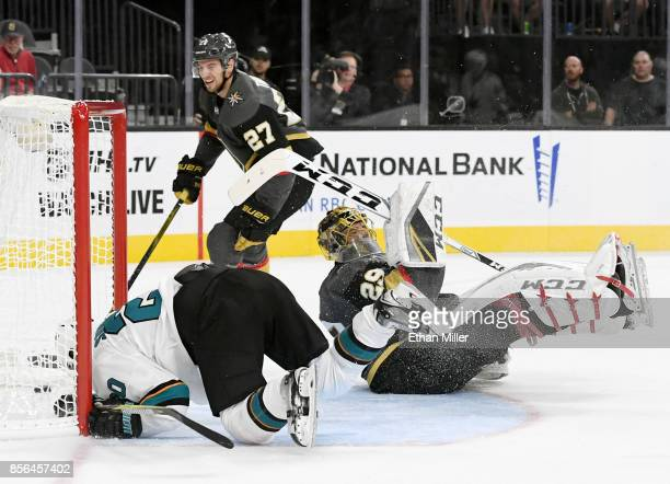 Marcus Sorensen of the San Jose Sharks falls into the goal after scoring against MarcAndre Fleury of the Vegas Golden Knights as Shea Theodore of the...