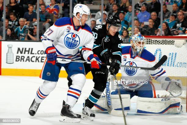Marcus Sorensen of the San Jose Sharks is defended by Oscar Klefbom and Cam Talbot of the Edmonton Oilers at SAP Center at San Jose on April 6 2017...