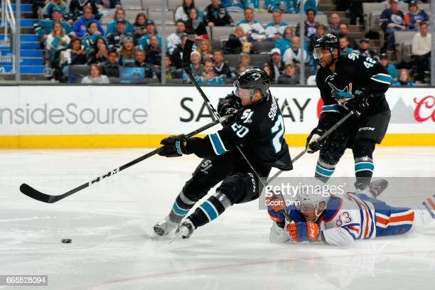 Marcus Sorensen of the San Jose Sharks is fouled by Matthew Benning of the Edmonton Oilers and gets the chance to take a penalty shot during a NHL...