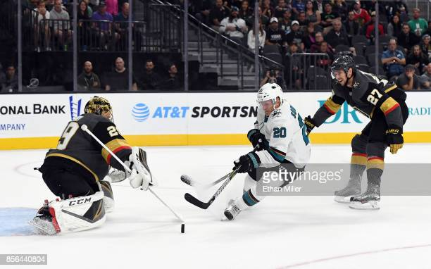 Marcus Sorensen of the San Jose Sharks scores a goal against MarcAndre Fleury of the Vegas Golden Knights as Shea Theodore of the Knights defends in...